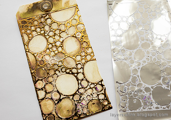 Layers of ink - Foil and Flowers Tag Tutorial by Anna-Karin Evaldsson. Add Thermoweb bronze foil.