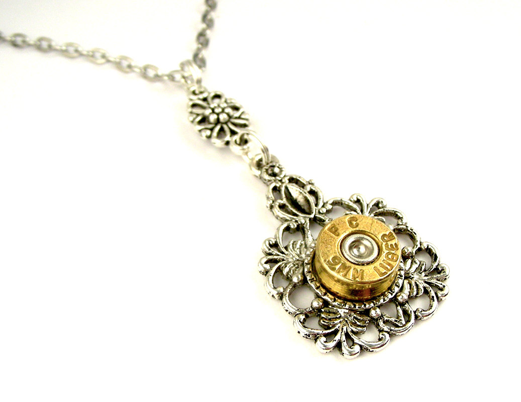 01-9mm-Luger-Pendant-Nicholas-Hrabowski-Steampunk-Jewelry-from-Recycled-Watches-and-Bullets-www-designstack-co