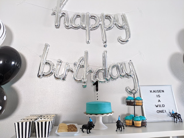 decoration and food on Ikea Kallax shelf for birthday party