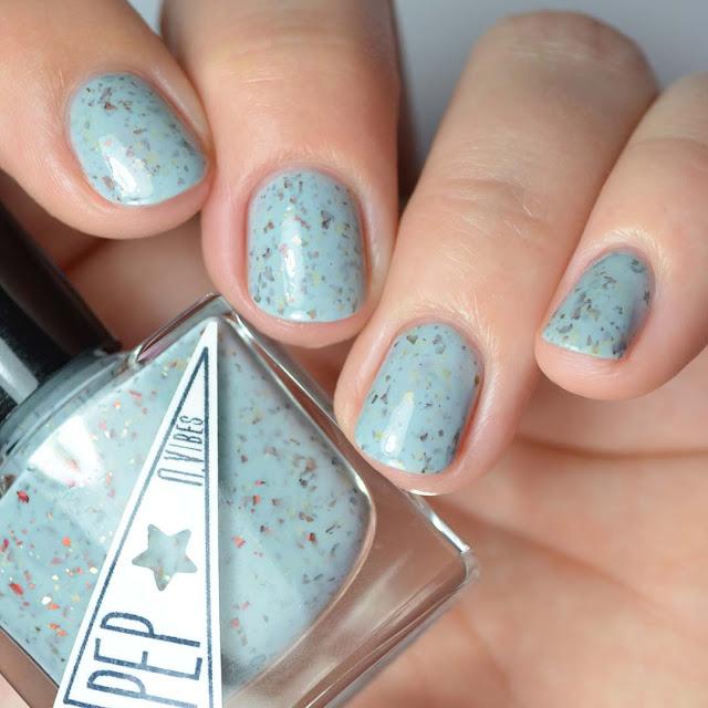 sky blue nail polish with flakies