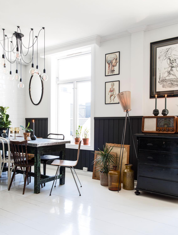 charming rustic scandinavian apartment, wood paneling, white floor, art,