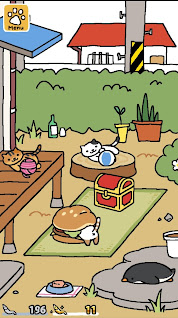 An Android screenshot of Neko Atsume's almost-too-simple gameplay