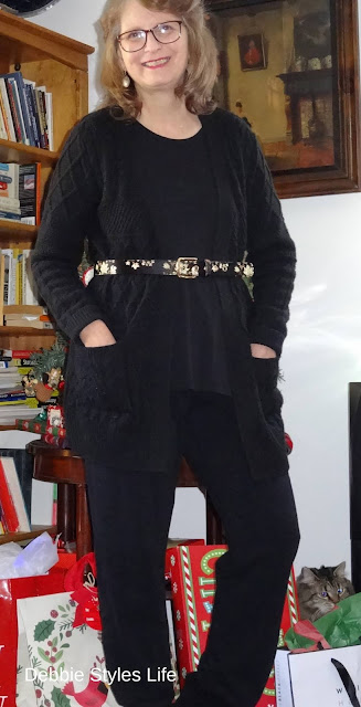 cardigan ribbed sweater worn with a belt