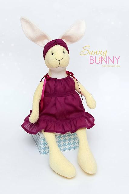 bunny toy in headband and sundress