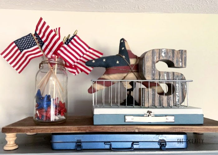 Last minute 4th of july decorating ideas -gray cabinet shelves vignette-flags, jar of stars, tool boxes