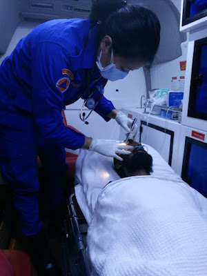 One of the participants checking the patient in an ambulance.