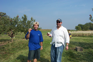 sunny boy and big mike apple picking at elegant farmer