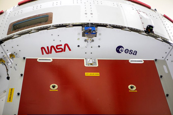 The NASA 'worm' and ESA (European Space Agency) logo are visible below the Crew Module Adapter of the Orion capsule that will launch on Artemis 1 next year.