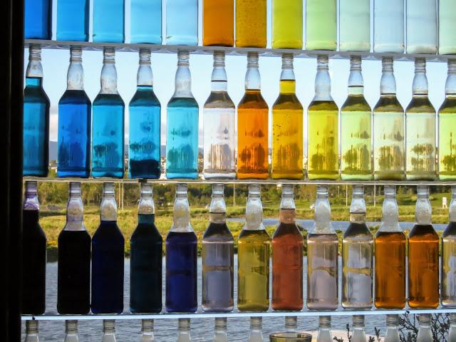 Colored glass bottles at AALTO Bistro in Reykjavik Iceland