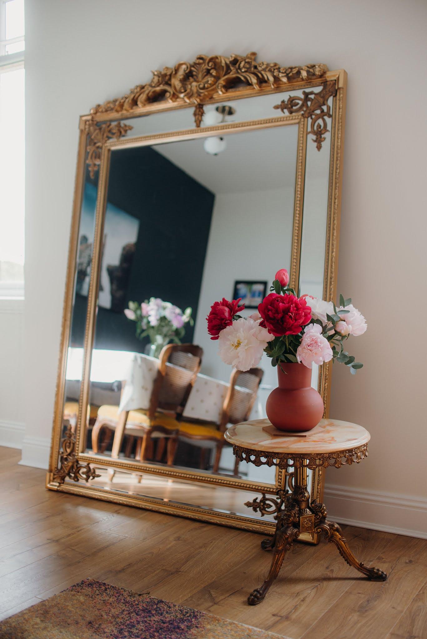 living dining room reveal large mirror antiques peonies plants liquid grain
