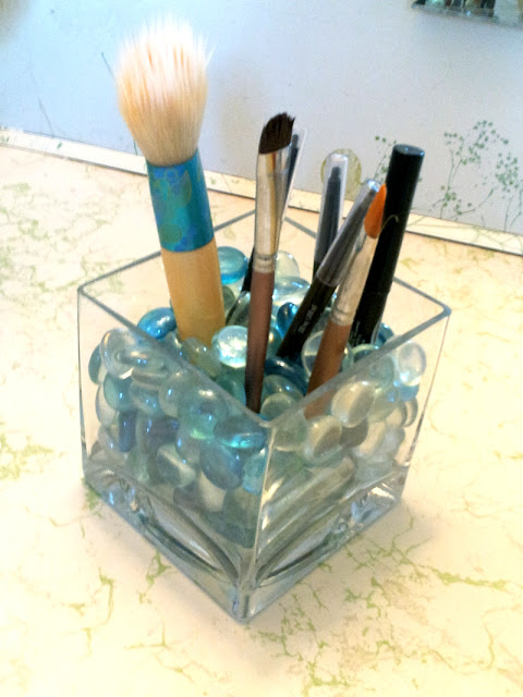 My FAVORITE way to store makeup brushes and eyeliner - easy to grab, plus it look pretty! via So Sew Organized
