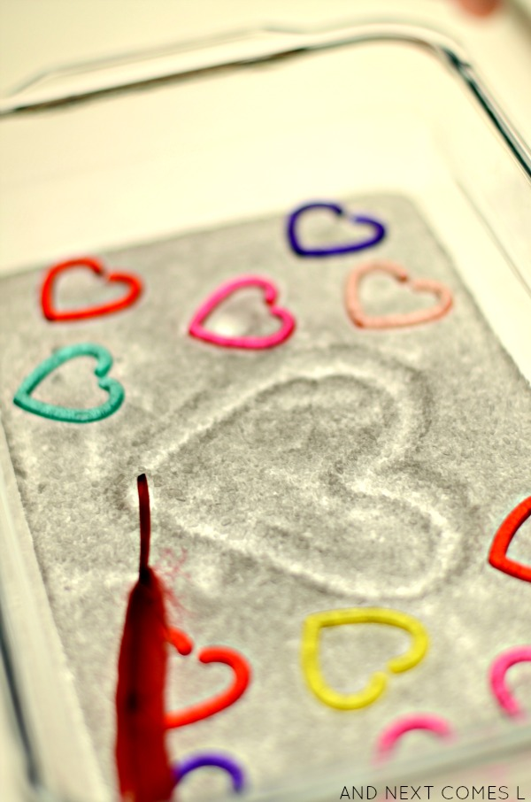 Valentine's themed salt tray for writing on the light table from And Next Comes L