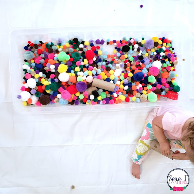 Pom pom sensory bin for kids