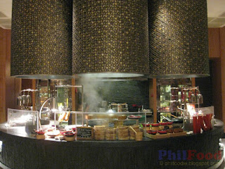 Picture of High Street Cafe's Wok station a counter with bamboo steamers, woks and dishes on display