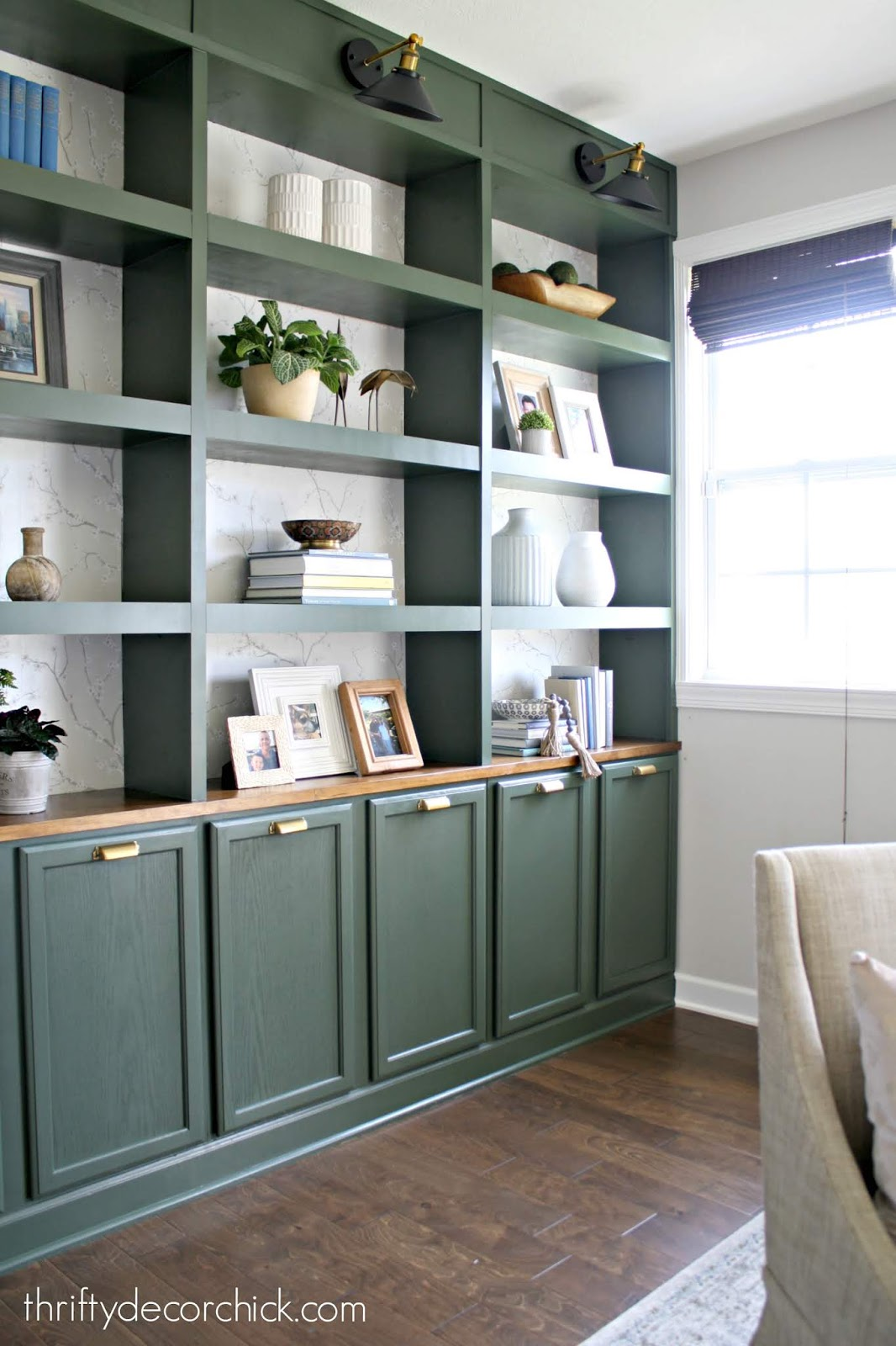 Green built ins with wallpaper