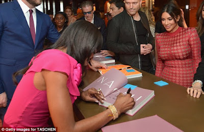 Photographs: Kim Kardashian and Naomi Campbell stagger at her book marking