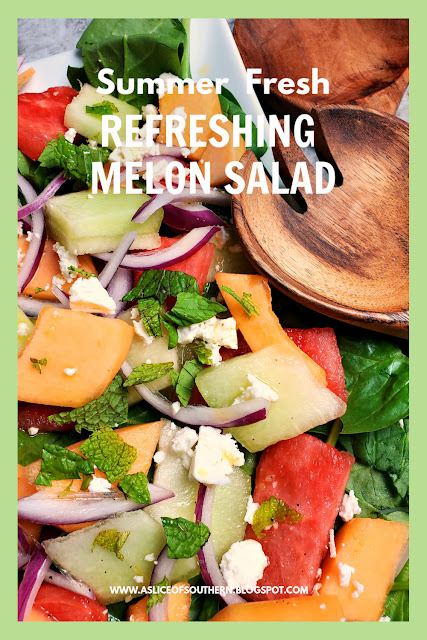 Refreshing Melon Salad:  Refreshingly cool and sweet melons mixed with onions and feta top a bed of baby spinach and doused with the most flavorful citrus garlic vinaigrette make one heck of a side dish! - Slice of Southern
