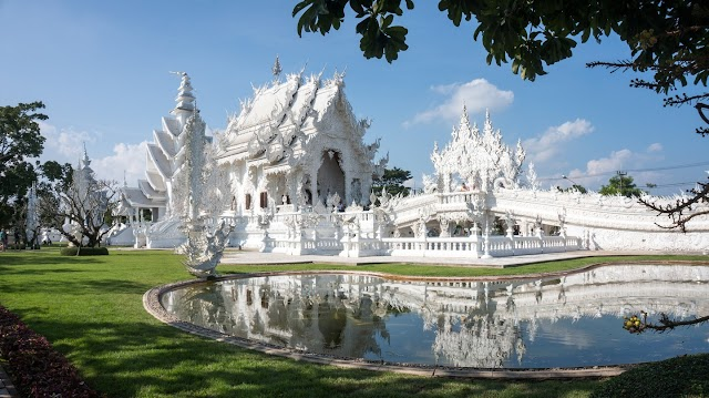 White pagodas attract visitors in South East Asia