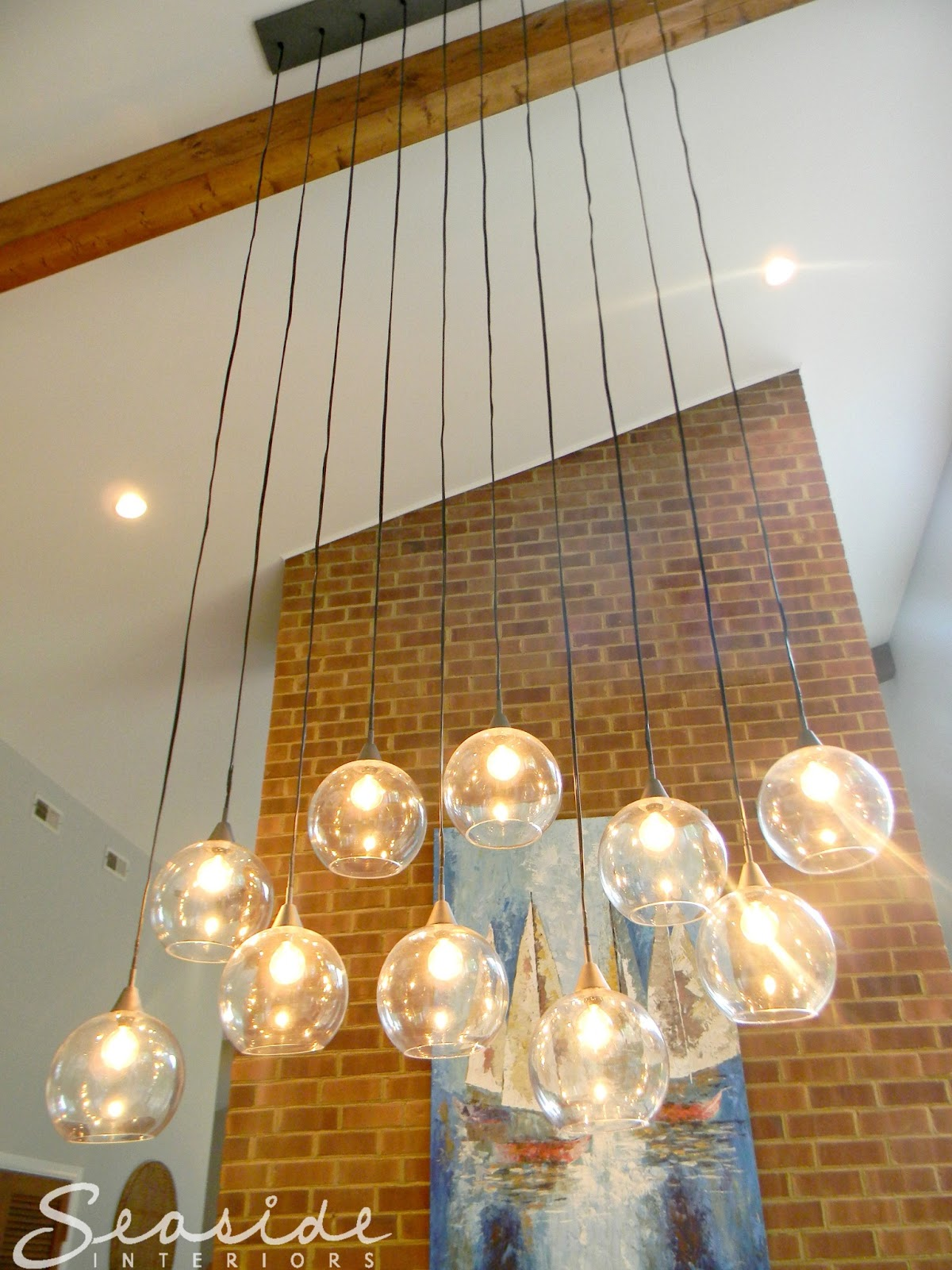 Seaside Interiors Dining Room Design Makeover Using The Cb2 Firefly Pendant
