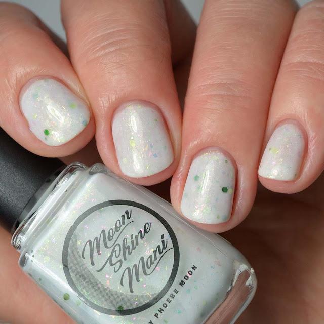 white glitter nail polish swatch