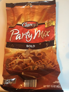 An open bag of Clancy's Bold Party Mix, from Aldi