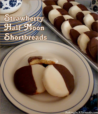 Strawberry Half Moon Shortbreads are crunchy strawberry flavored cookies dipped in chocolate and white chocolate. | Recipe developed by www.BakingInATornado.com | #recipe #cookies