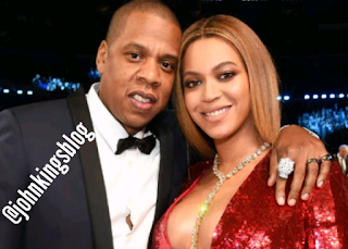 Jay-Z on suit and Beyonce on Red