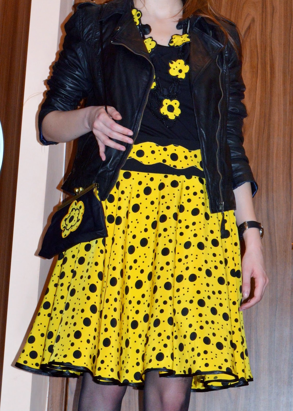 Yellow and black polka dots skirt with leather jacket