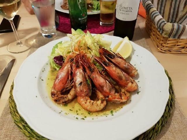 Prato de comida no restaurante Osteria Mercede em Palermo