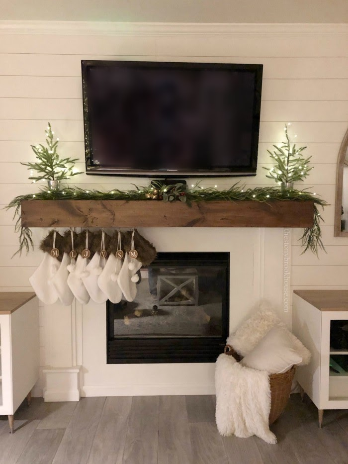 Our Less is More Christmas living room mantel at night