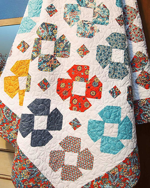 Dizzy Daisy Quilt Free Tutorial designed by Jenny of Missouri Quilt Co