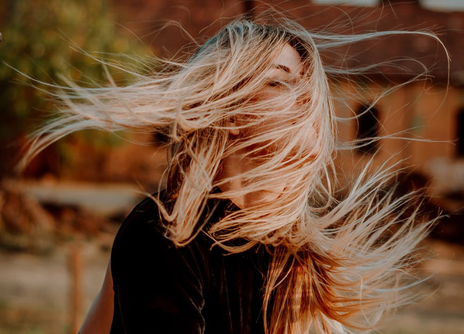 woman with straight blonde hair blowing in the wind