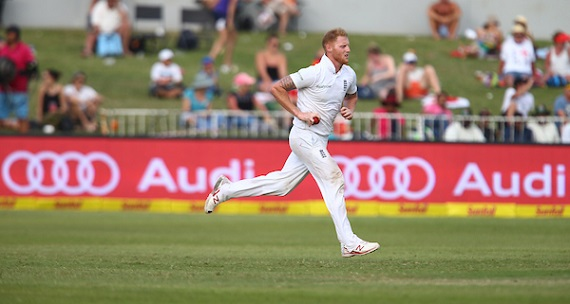 Ben Stokes runs in to bowl in Test whites