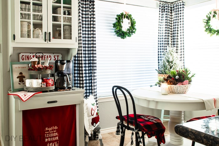 Christmas breakfast nook and cocoa bar with red cabinet skirt