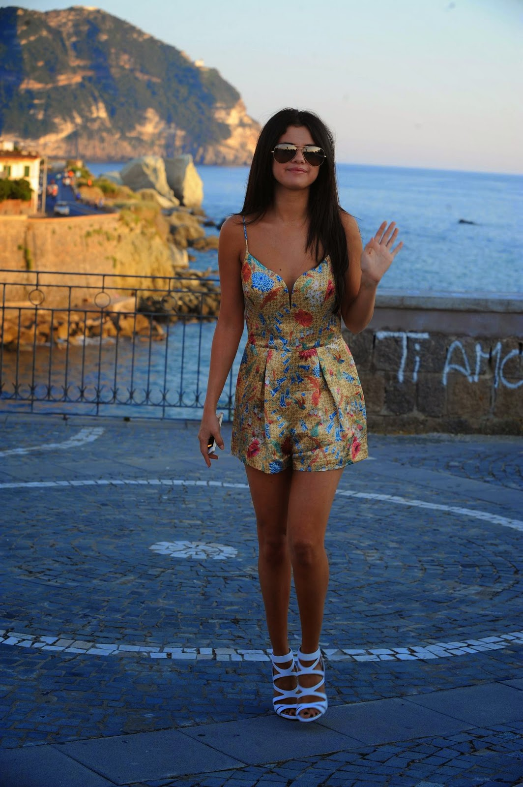 Selena Gomez in a floral mini romper out and about in Ischia