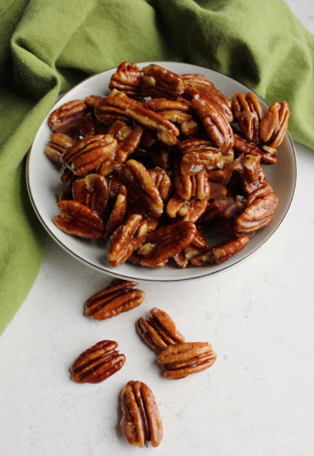 honey coated pecans spilling out of bowl