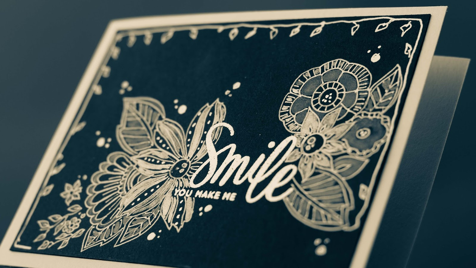 handdrawn doodle flowers arround white embossed sentiment twinkling H2o side view, black and white