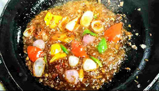 Simmering vegetables like bell peppers capsicum onion
