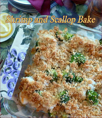 Shrimp and Scallop Bake, shellfish and broccoli bake together in this dish that assembles and bakes in ½ hour. Perfect for either a weeknight dinner or a special occasion. | Recipe developed by www.BakingInATornado.com | #recipe #dinner