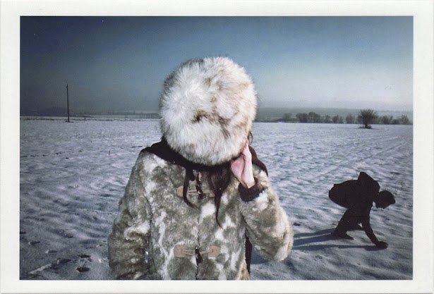 dirty photos - Once - street photo of girl with fur hat and man playing on snow in bulgaria