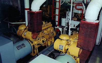 Twin Caterpillar 3306's side by side in tugboat engine room