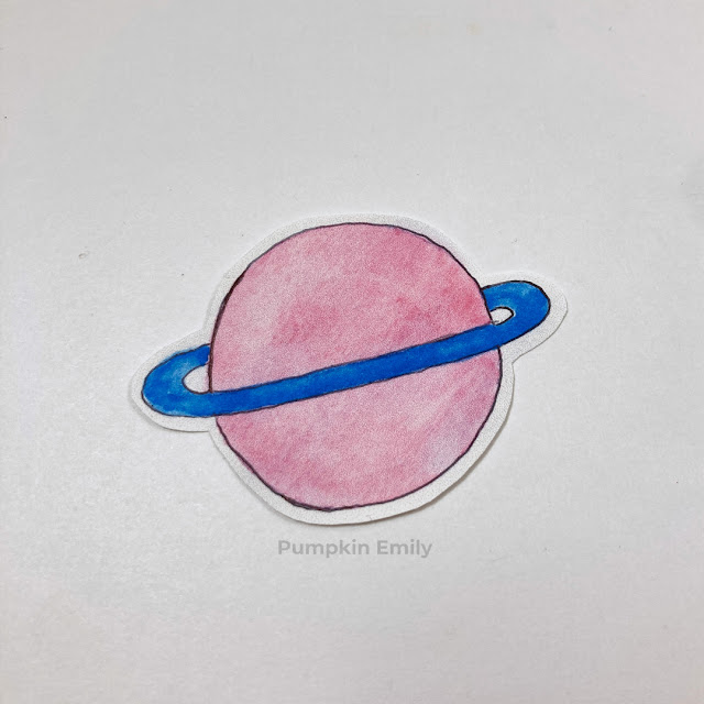 A planet sticker made out of sticker paper.