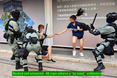 "HK Cops arrest a pair of students disobeying the ""No Mask"" Ordinance"