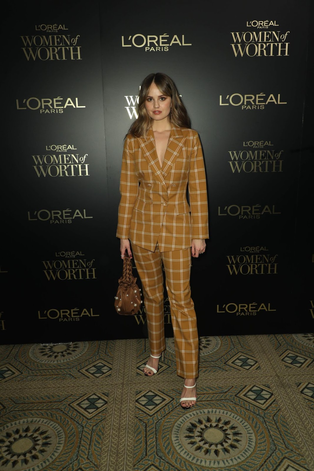 Debby Ryan arrives in plunging plaid suit at the L'Oreal Women of Worth Awards 2019 in NYC