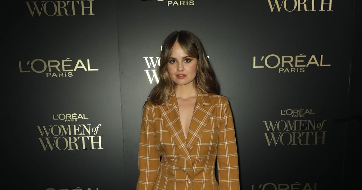 Debby Ryan arrives in plunging plaid suit at the L'Oreal ...