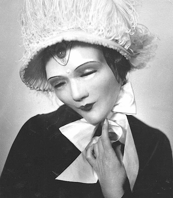 a 1926 William Mortensen photograph of a masked woman