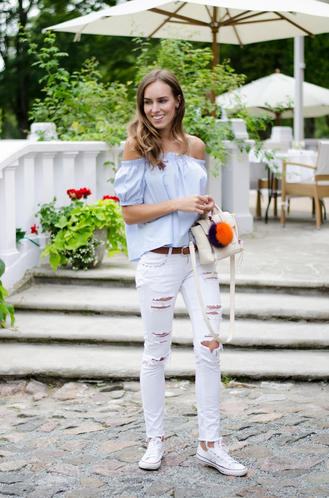 kristjaana mere off shouler top white ripped jeans