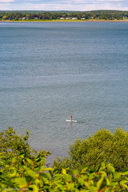 Portland, Maine USA July 2020 photo by Corey Templeton. A lone stand up paddle boarder off the Eastern Promenade on this steamy summer day.