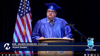 Snapshot of Cuevas at graduation ceremony delivering his speech