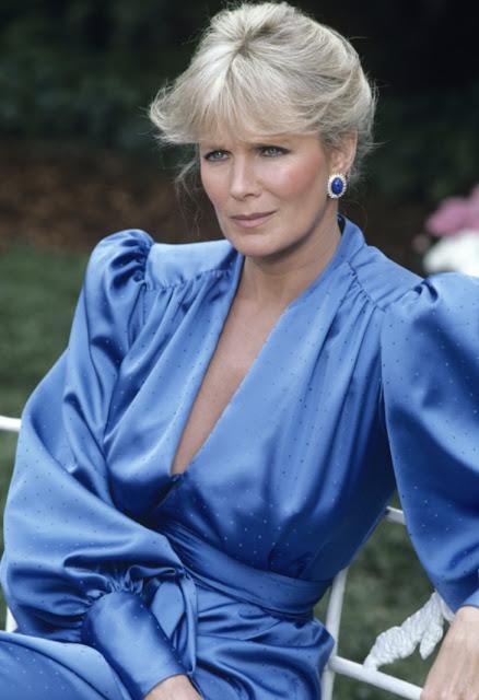 Dynasty 1980s fashion style blue dress